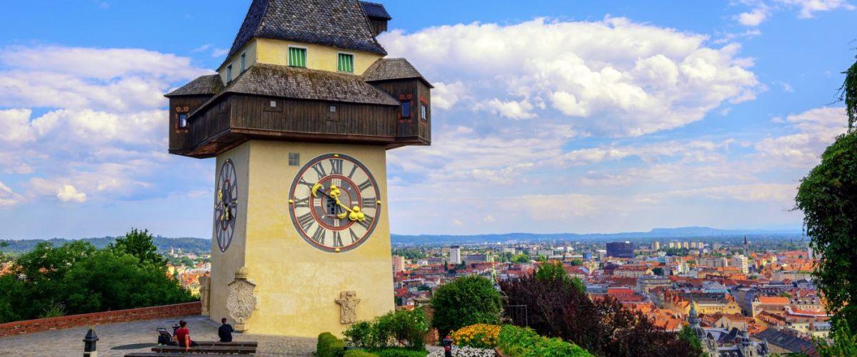 The medieval Clock tower Uhrturm is a symbol of Graz, Austria (c) Herrgottsgarten